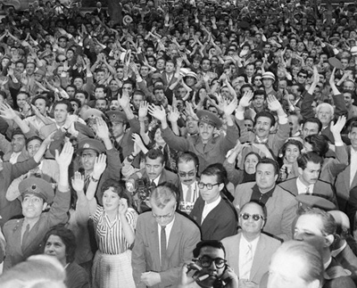 Barney is hiding in this crowd, can you find him smoking?